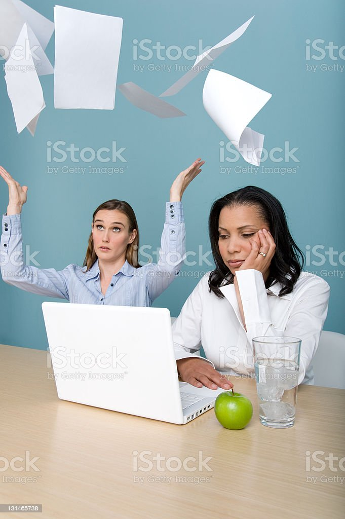 Business woman throwing papers royalty-free stock photo