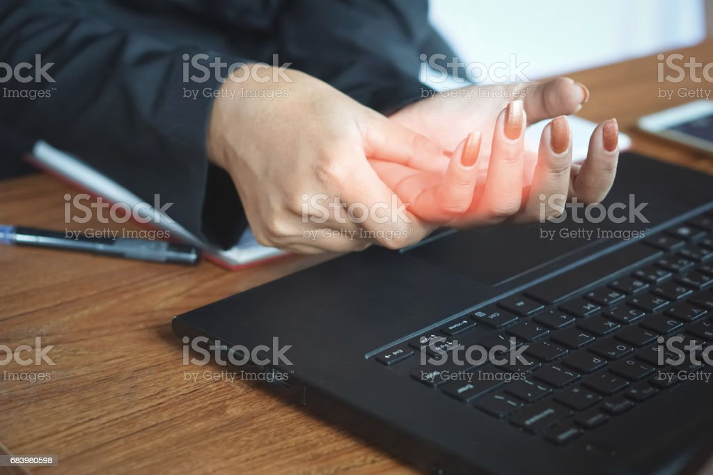 business woman tired hand from work hard on computer, laptop, phone. stock photo