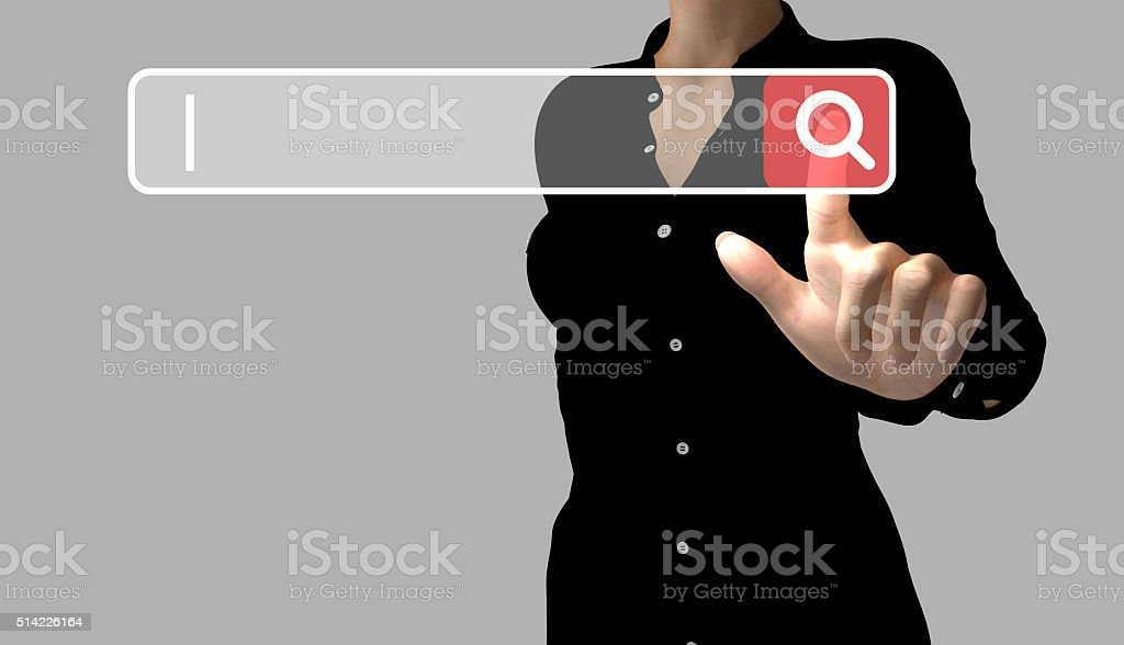 Business woman touches a search button stock photo