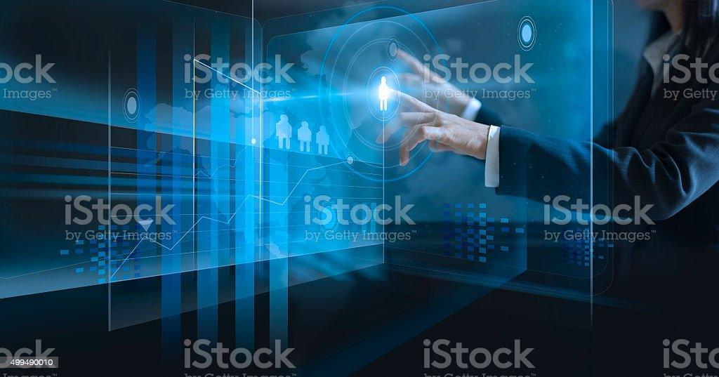 business woman touching virtual screen, pushing icon on media stock photo