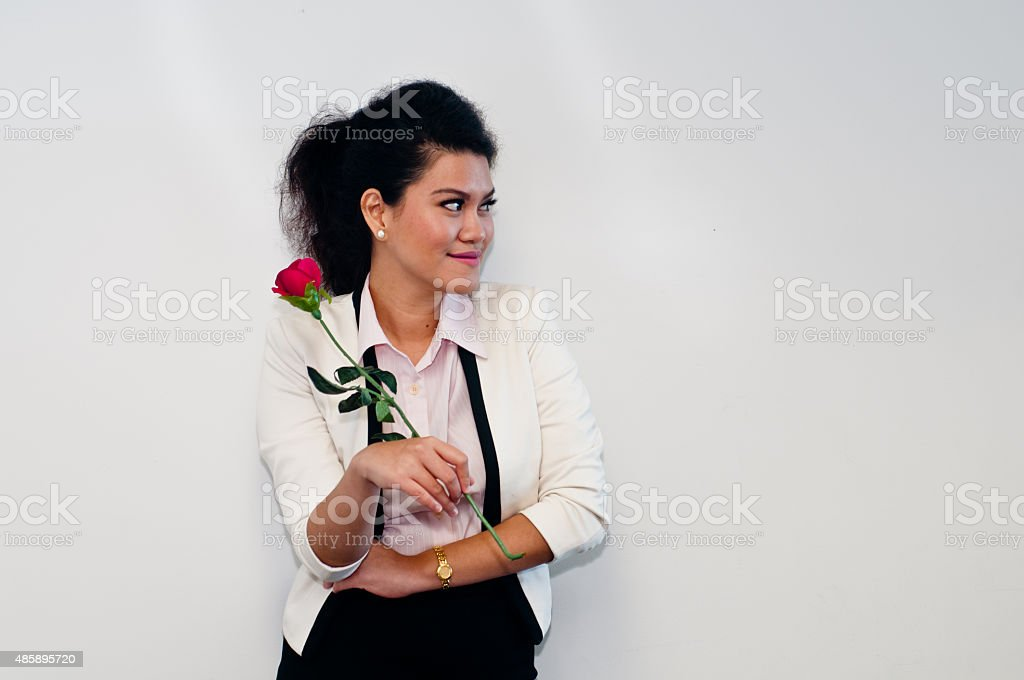 Business woman turn face left and hold red rose stock photo