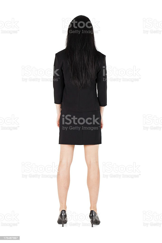 Business woman turned backwards isolated stock photo