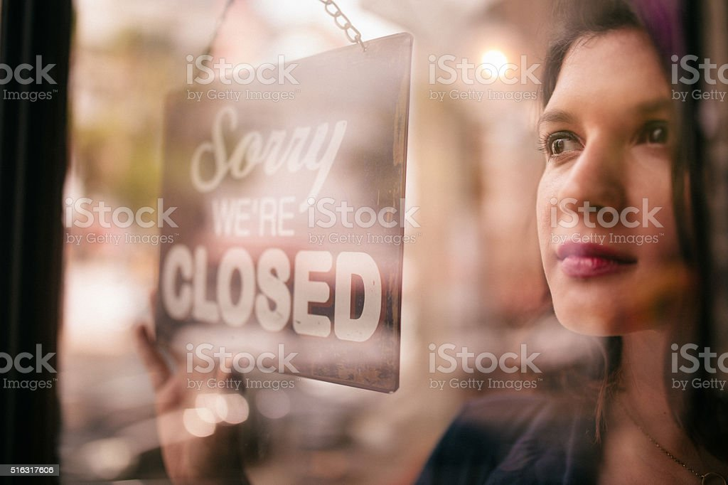 Business Woman Turning Closed Sign on Door of coffee Shop stock photo