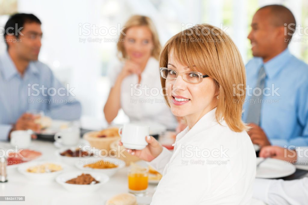 Business woman turning towards the camera in a restaurant. royalty-free stock photo