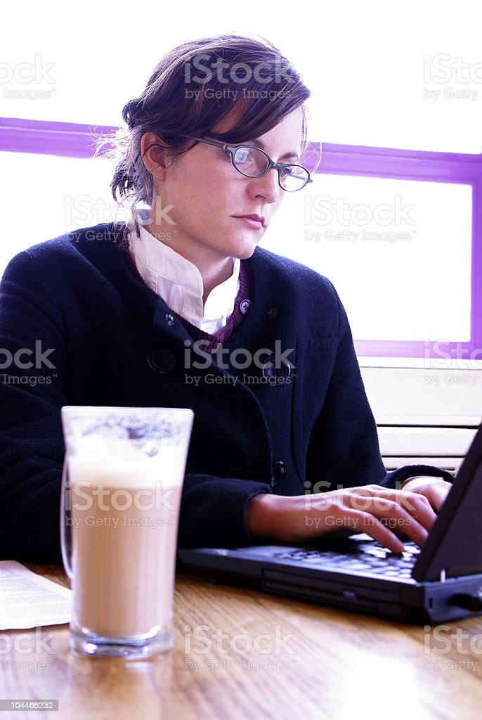 Business woman typing with thick latte royalty-free stock photo