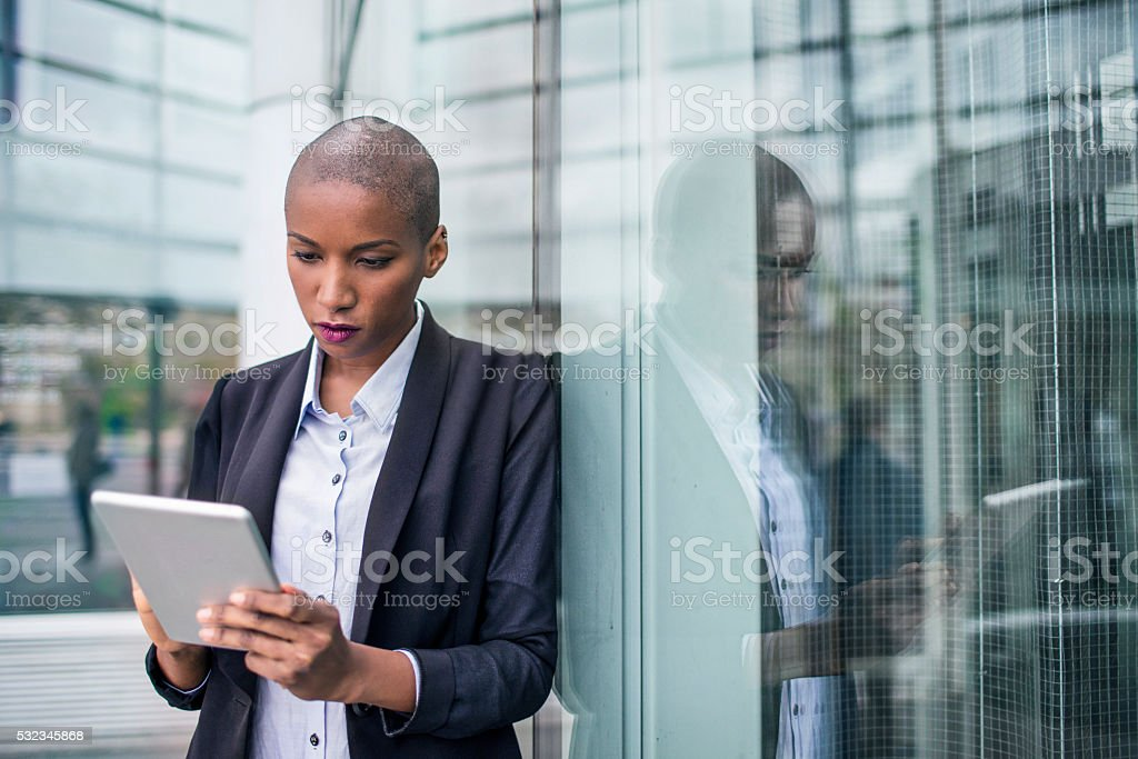 Business woman using a digital tablet stock photo