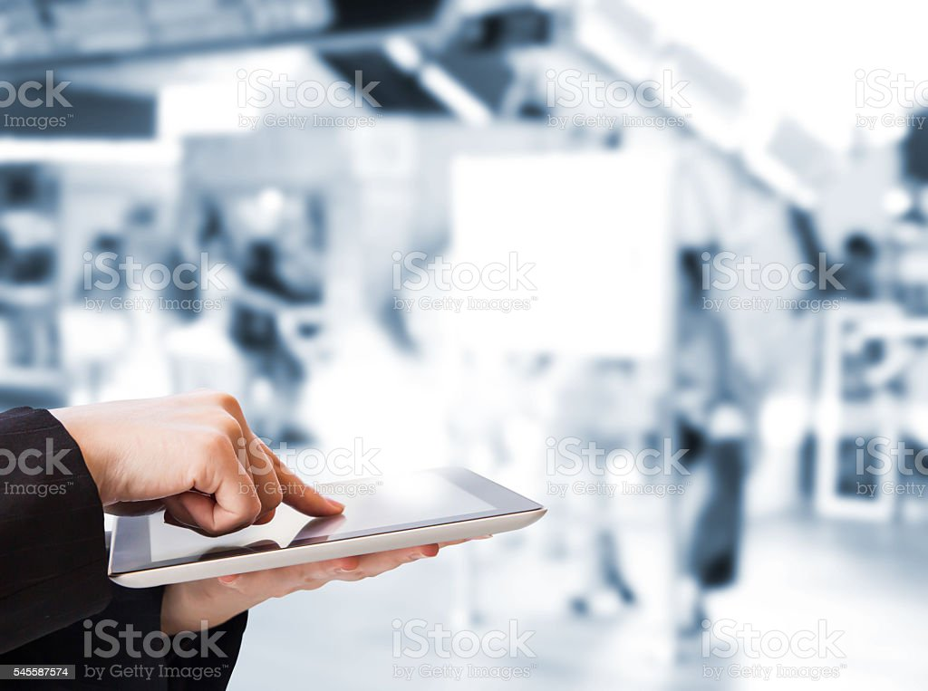 Business woman using digital tablet in the skytrain station stock photo