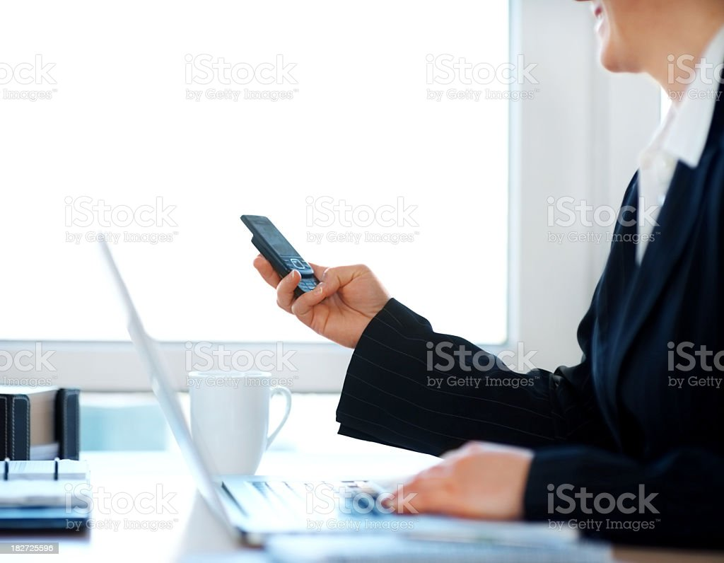 Business woman using laptop and mobile phone royalty-free stock photo