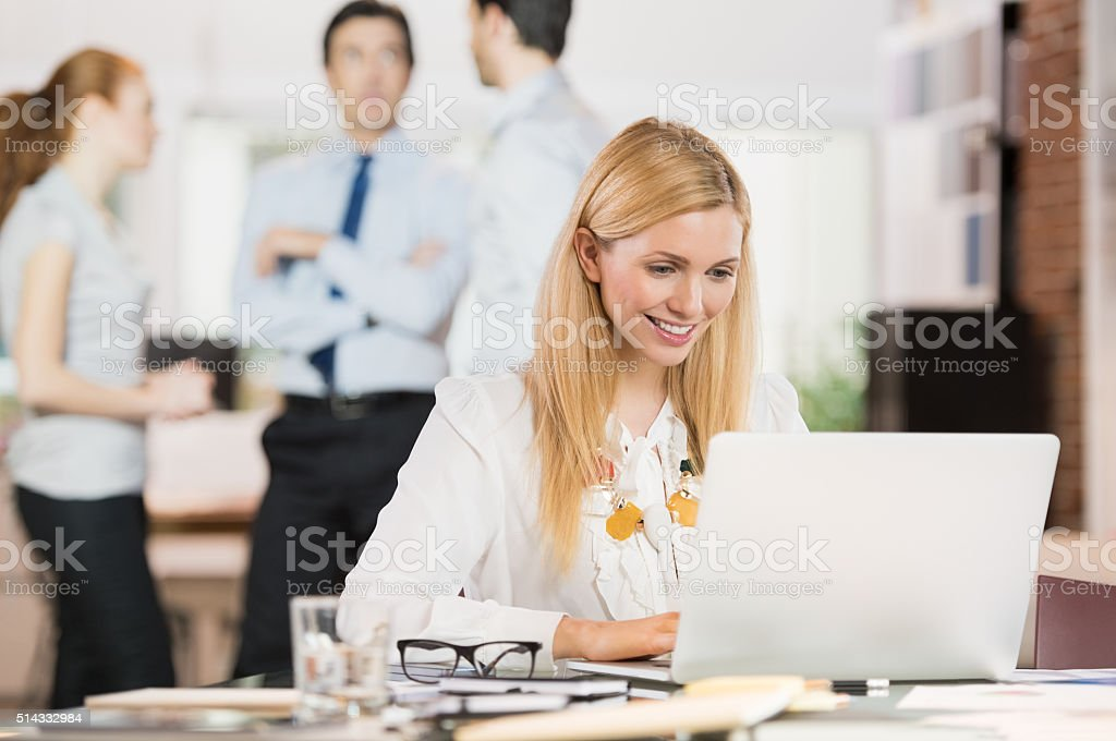 Business woman using laptop stock photo