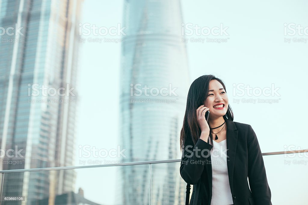 Business woman using mobile stock photo