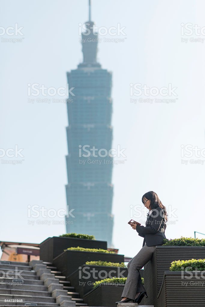 Business woman using smartphone in city. stock photo
