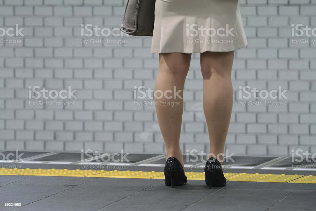 Business woman waiting for the train royalty-free stock photo
