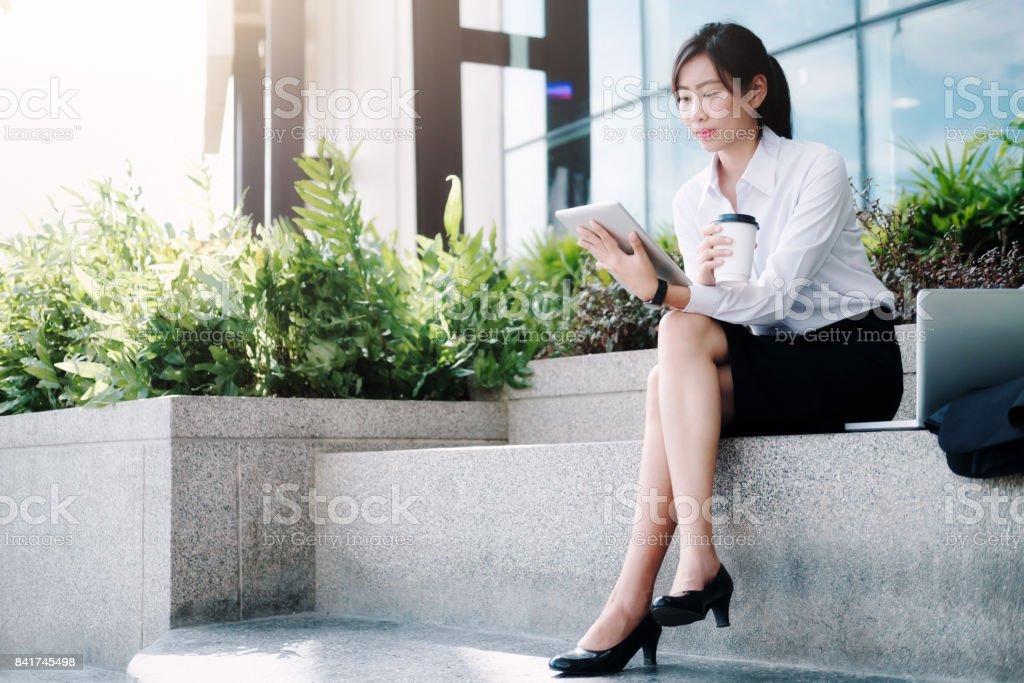 Business woman walking drinking coffee. stock photo