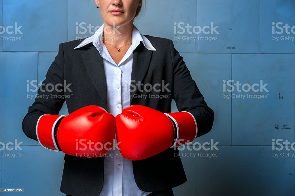 business woman wearing suit, and red boxing gloves stock photo