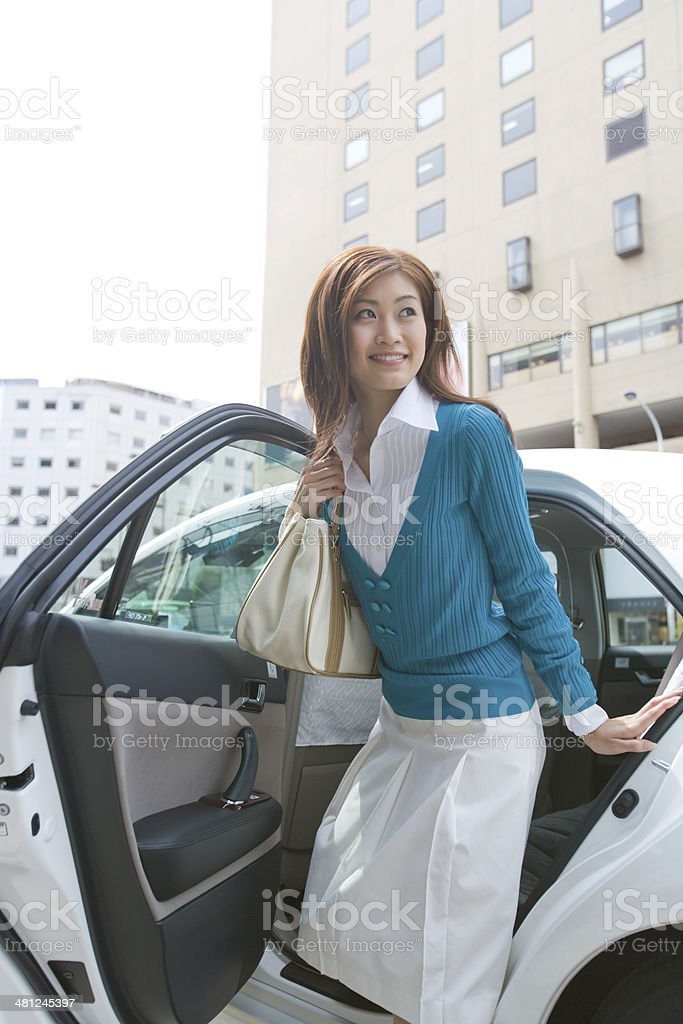 Business woman who gets out of taxi stock photo