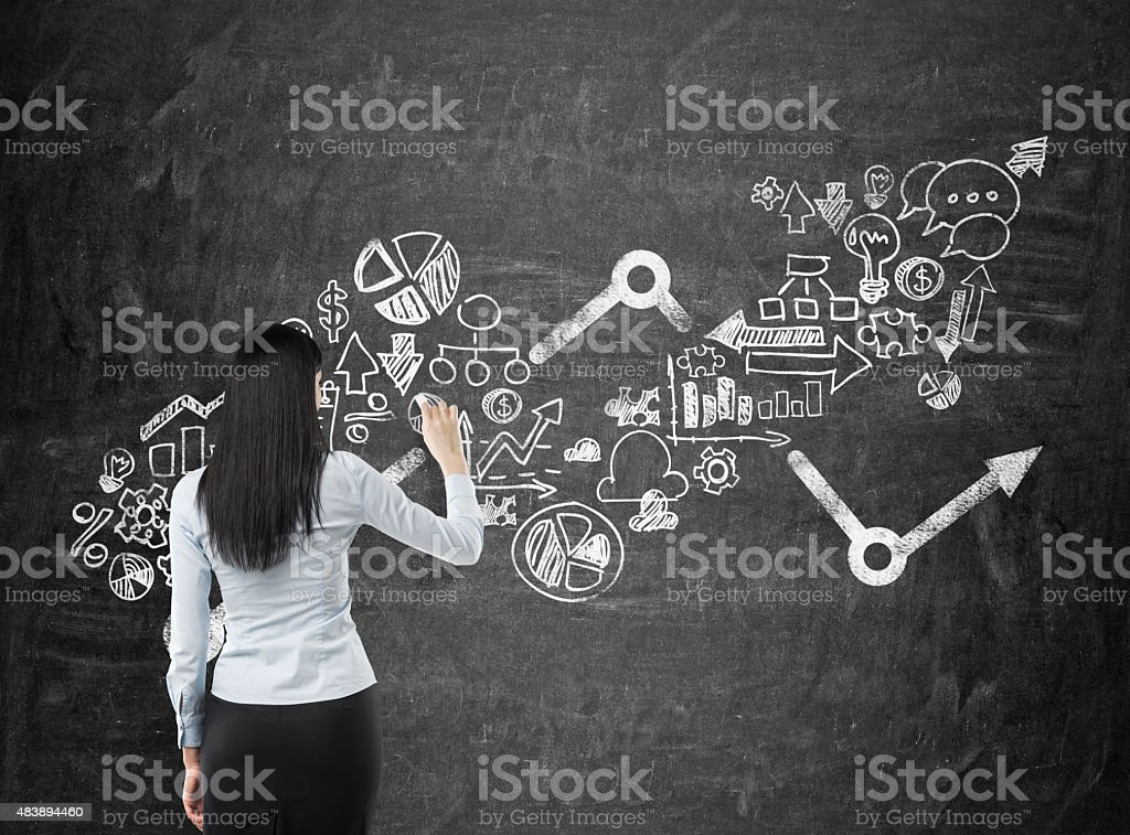 business woman who is drawing an arrow stock photo