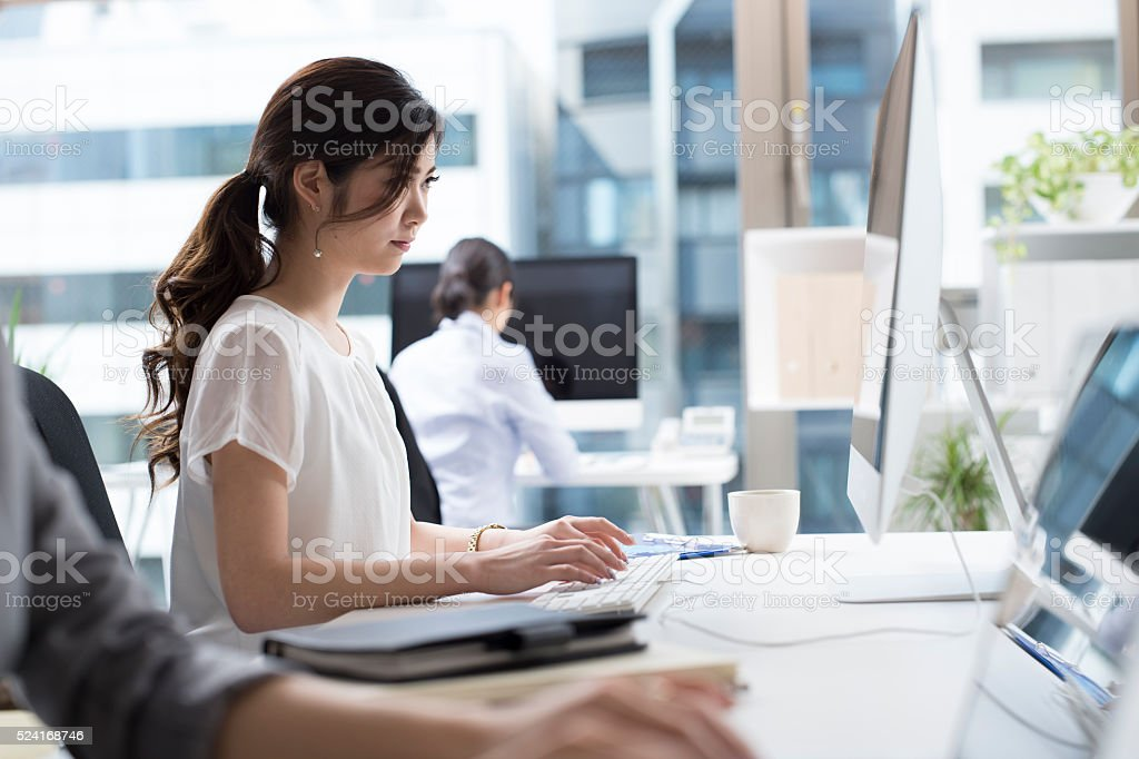 Business woman who works in the office stock photo