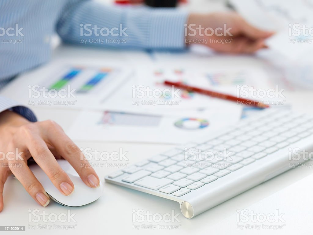 Business woman who works using a personal computer stock photo
