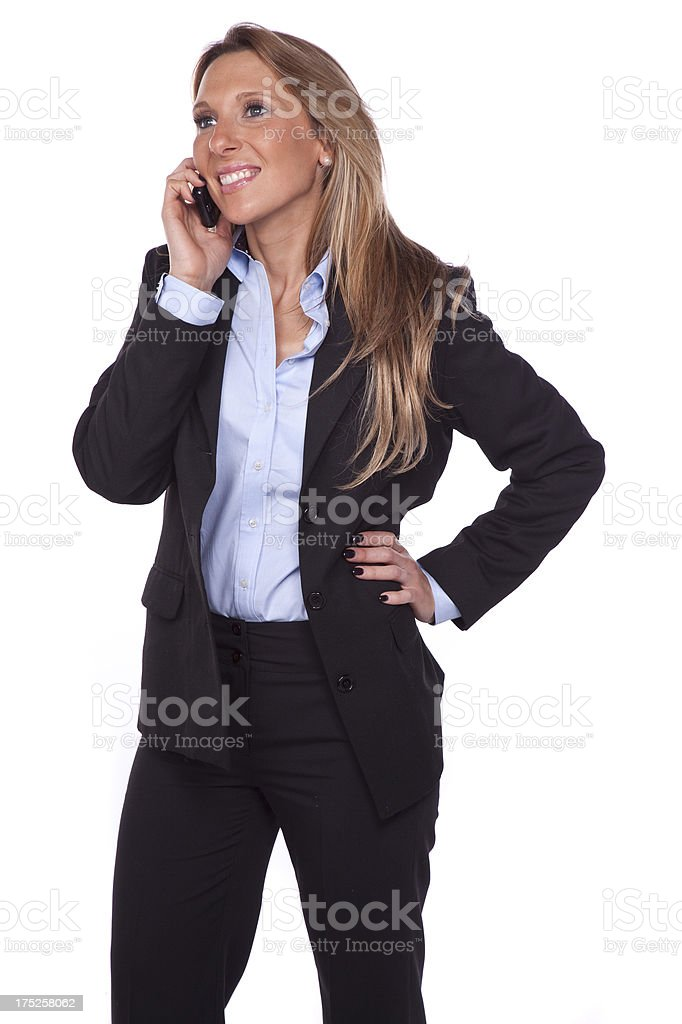 Business woman with a cell phone isolated in white background. royalty-free stock photo