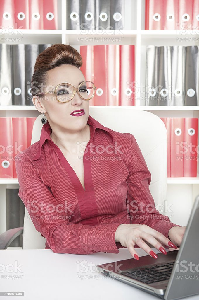 Business woman with a suspicious expression stock photo