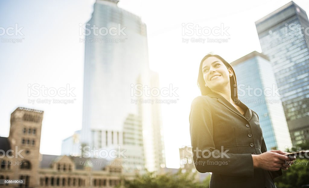 business woman with arm crossed on urban scene stock photo