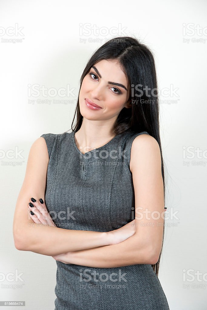 Business woman with arms crossed. stock photo