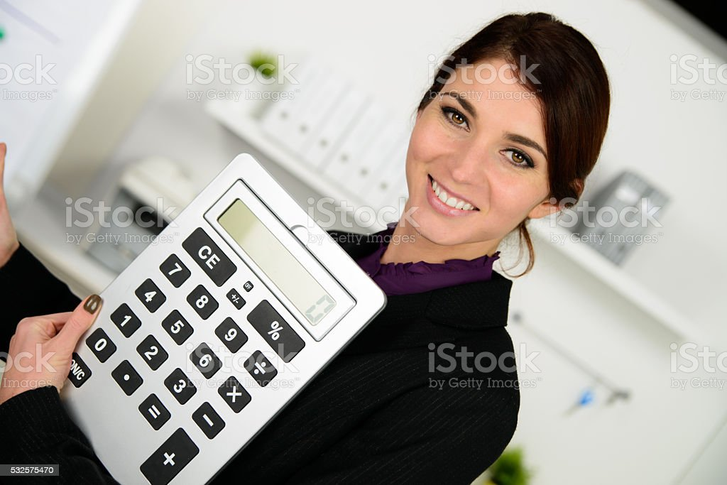 business woman with big calculator stock photo