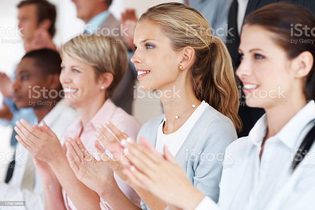 Business woman with colleagues applauding at a seminar stock photo
