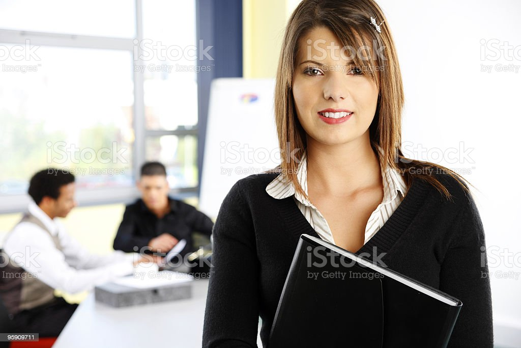 Business woman with colleagues in modern office royalty-free stock photo