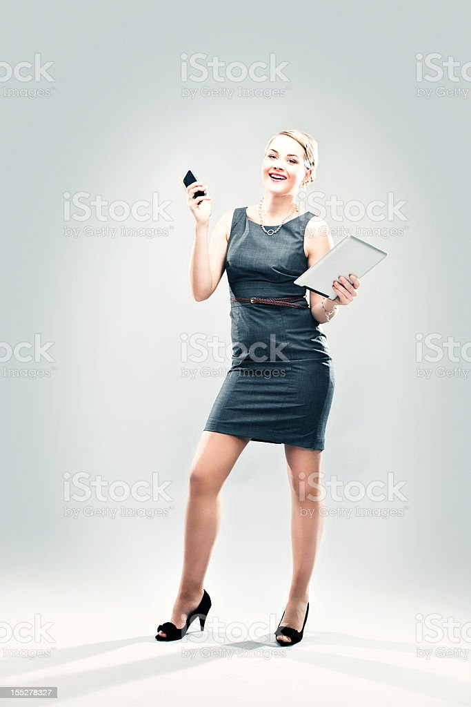 Business woman with digital tablet and phone royalty-free stock photo