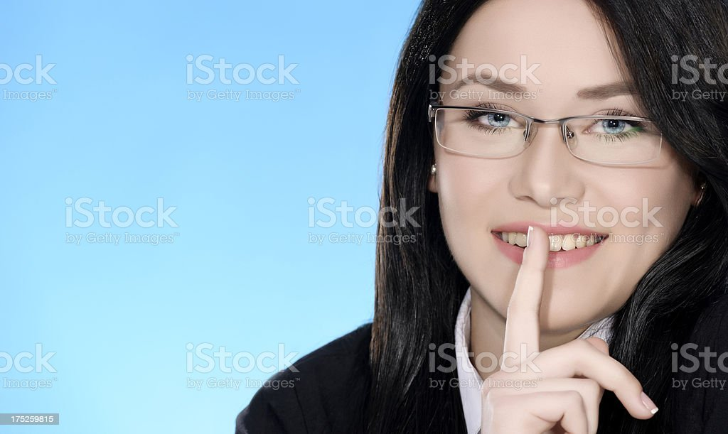 business woman with finger on lips royalty-free stock photo