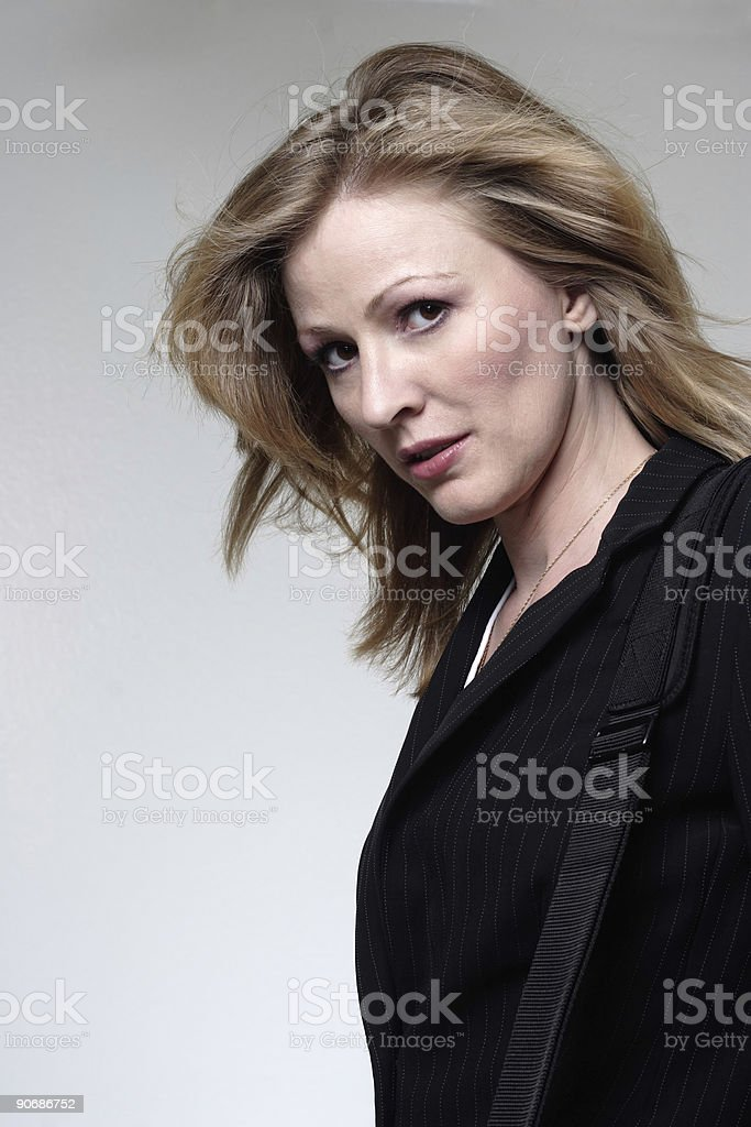 Business woman with hair blowing stock photo