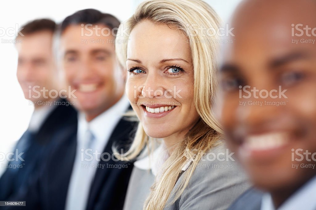 Business woman with her colleagues stock photo