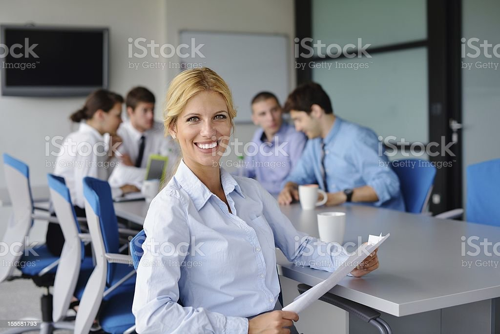 business woman with her staff in background at office royalty-free stock photo