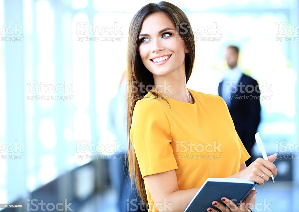 business woman with her staff, people group in background stock photo
