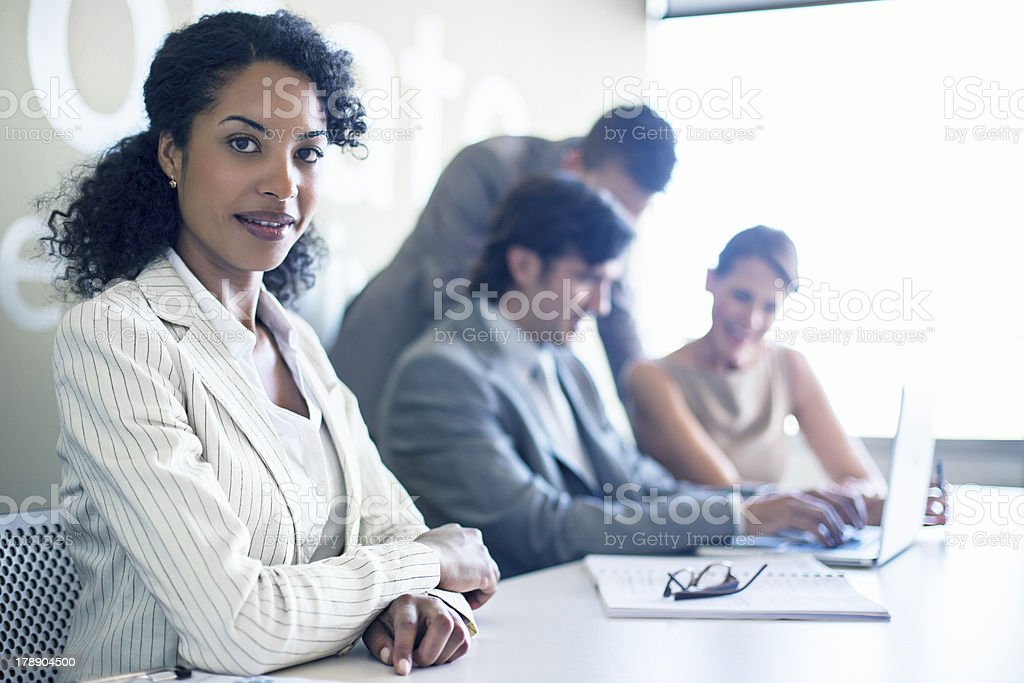 Business woman with her teamwork in the background royalty-free stock photo