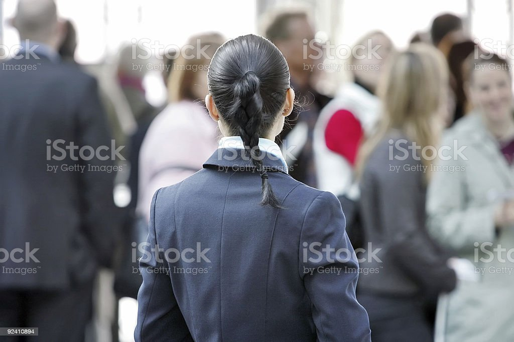 business woman with large group of people in the background royalty-free stock photo