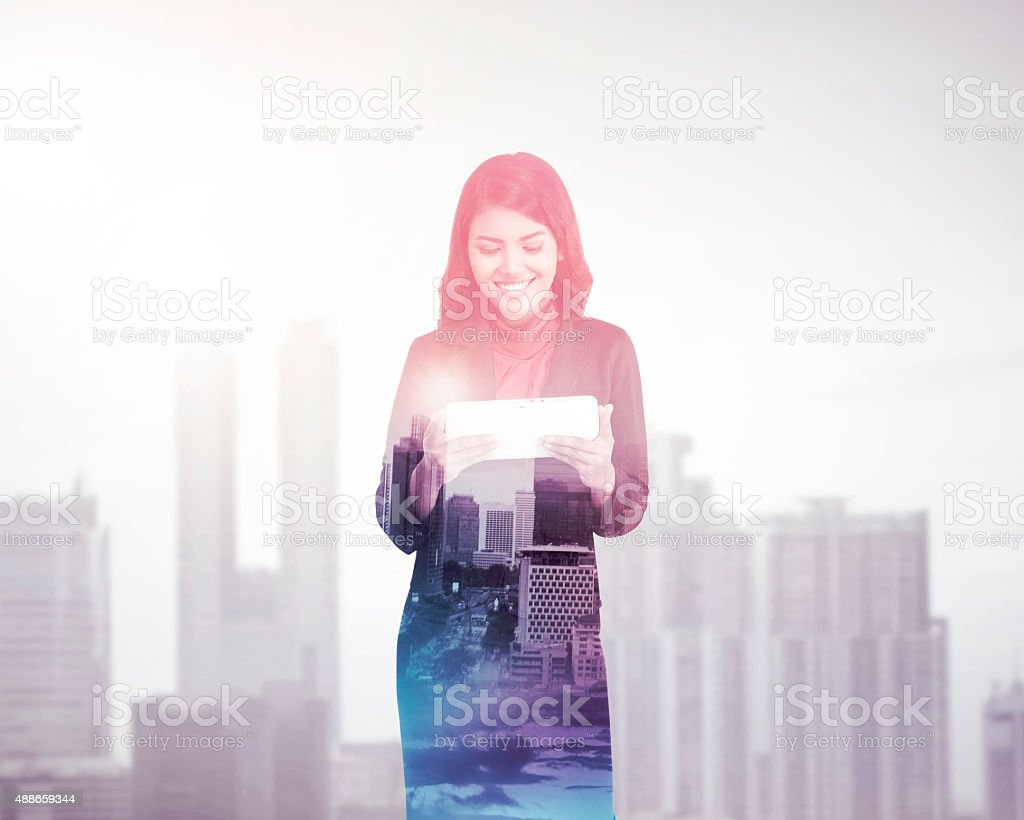 Business woman with multiple exposure holding tablet computer stock photo