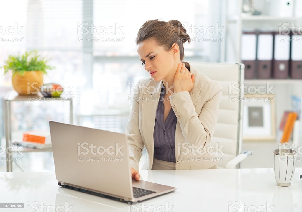 business woman with neck ache stock photo