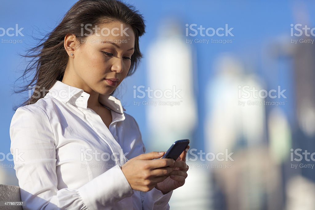 Business woman with smart phone stock photo