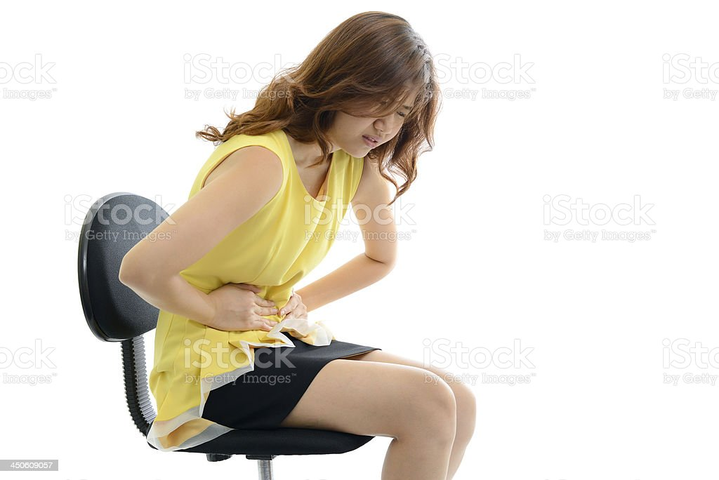 Business woman with stomach issues. Isolated on white background royalty-free stock photo
