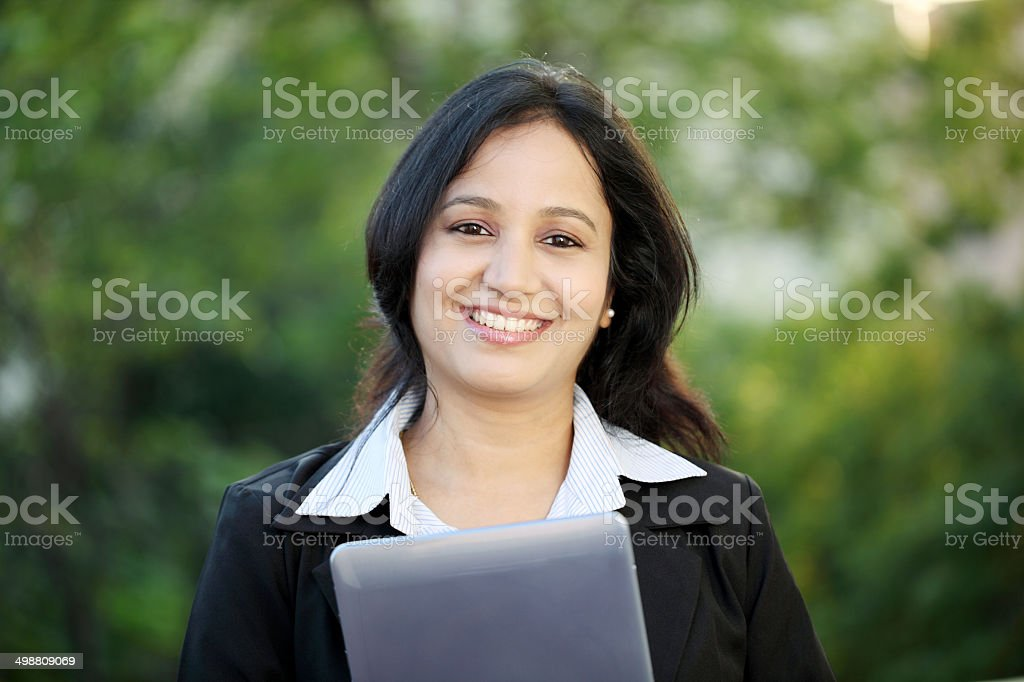 Business woman with tablet computer at outdoors stock photo