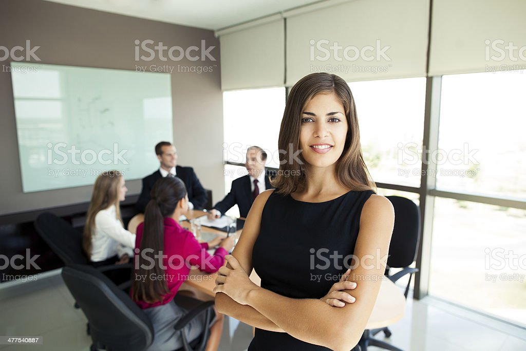 Business woman with team behind her royalty-free stock photo