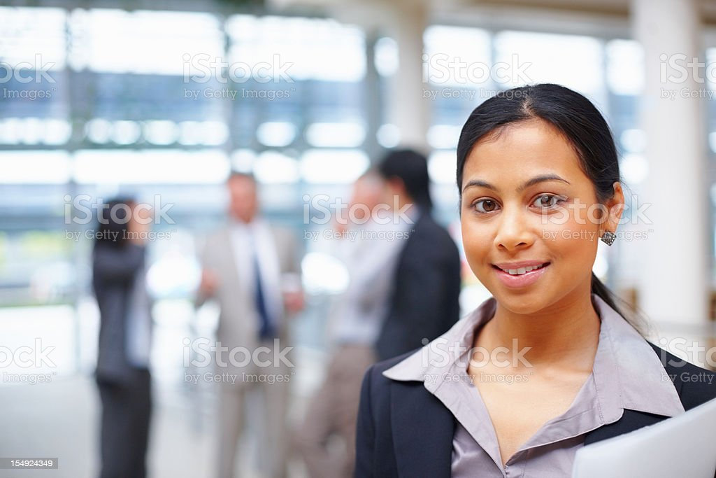 Business woman with team in background stock photo