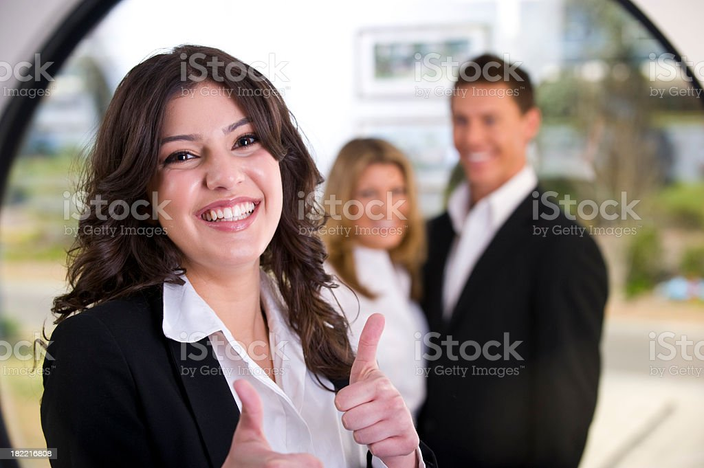 Business woman with thumbs up royalty-free stock photo
