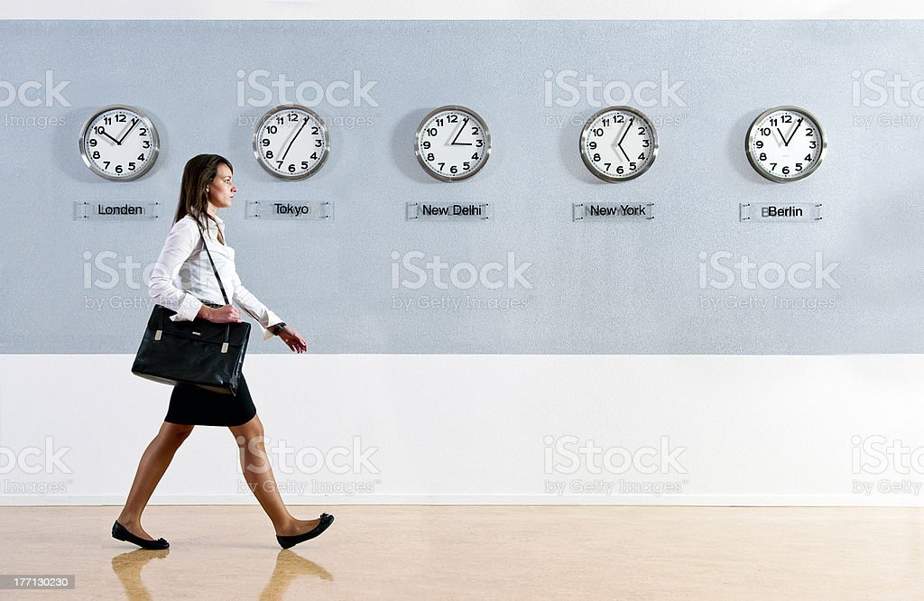 Business woman with world time clocks stock photo