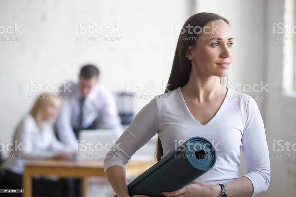 Business woman with yoga mat stock photo