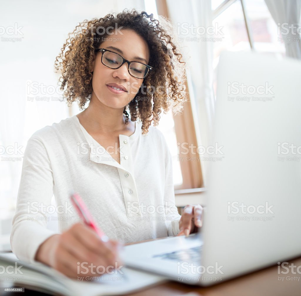 Business woman working as a freelance stock photo