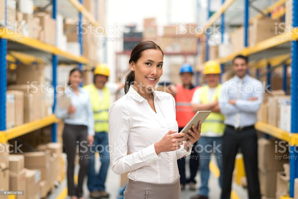 Business woman working at a warehouse stock photo