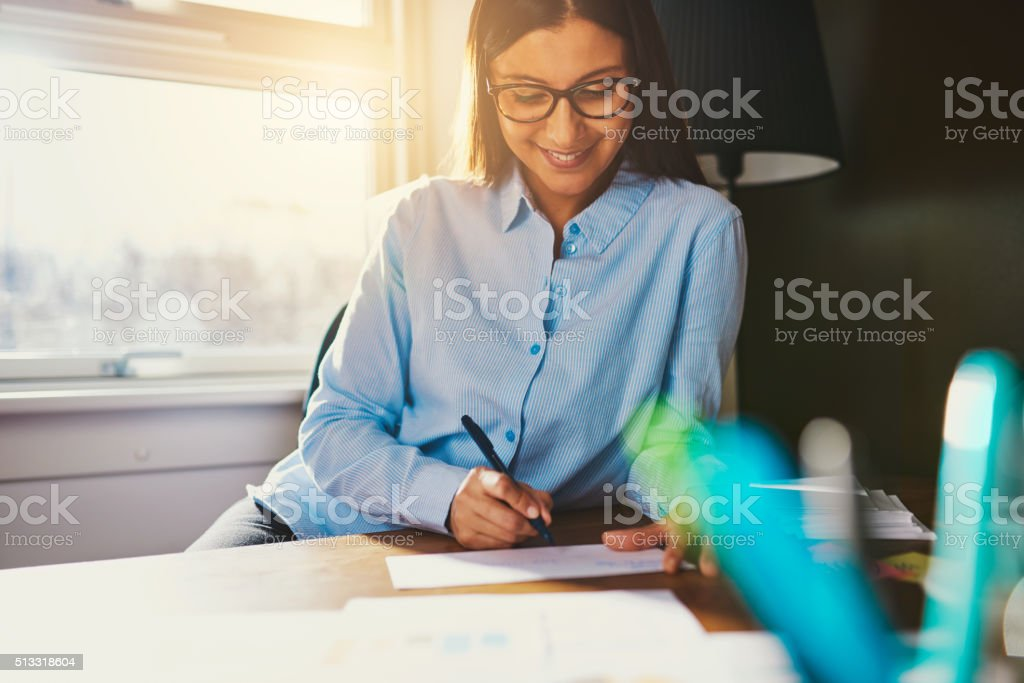 Business woman working at desk stock photo